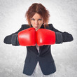 Redhead girl with boxing gloves
