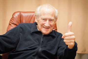 laughing old man with thumbs up