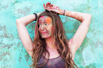 Portrait of girl with colorful paint on her face