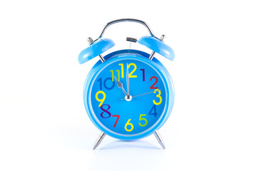Alarm Clock isolated on white, in blue, showing eleven o'clock.