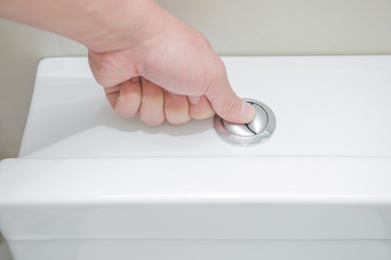 pushing a button to flush a closestool