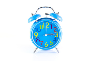 Alarm Clock isolated on white, in blue, showing three o'clock.