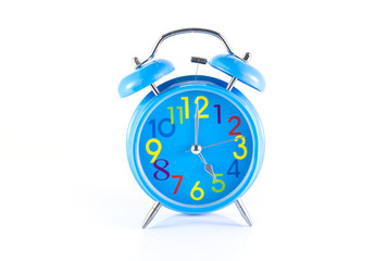 Alarm Clock isolated on white, in blue, showing five o'clock.
