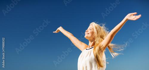 Leinwanddruck Bild beautiful woman enjoying summer outdoors