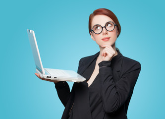 Surprised business women with laptop