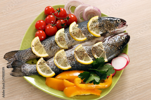 trout with vegetables on plate
