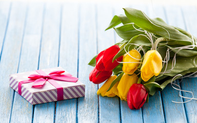 Gift box and bouquet of tulips