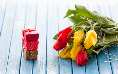 Gift boxes and bouquet of tulips