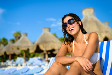 Happy woman on vacation at tropical resort beach