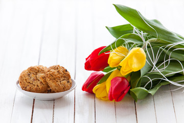 Cookies and bouquet of tulips