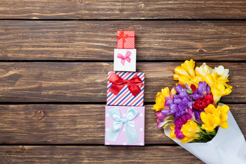 Gift boxes and bouquet of flowers