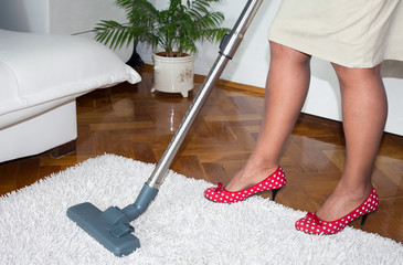 Vacuum cleaning carpet in the room
