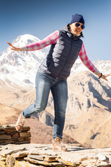 Cheerful girl tourist in mountains