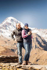 young couple on a background of mountains