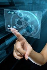 a woman finger synchronise  data on a digital screen
