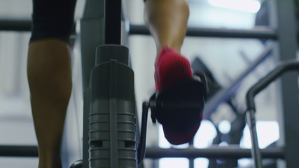 Close up of feet on an exercise bike in slow motion