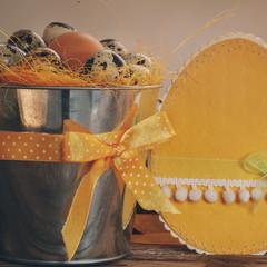 closeup quail eggs in a bucket, happy Easter decorations