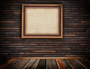 Vintage wooden frame on brickwall.