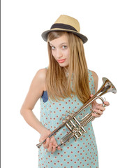a teenage girl with a trumpet and a hat