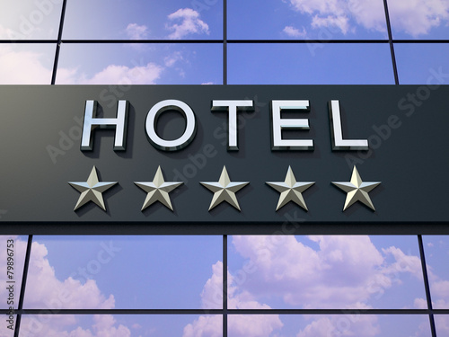 The hotel sign with five stars. - 79896753
