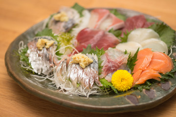 Traditional fresh sashimi raw fish plate in Japan