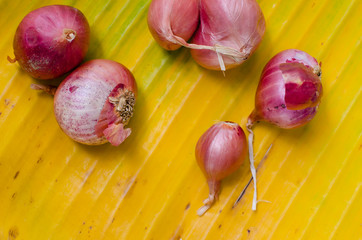 Thai Red Onion On Yellow Banana Leaf.