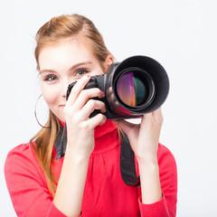 Pretty, female photographer with her digital camera