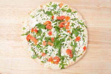 frozen pizza on wooden board