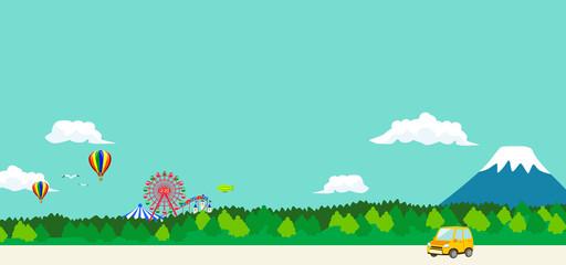 遊園地と山