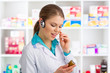 Woman doctor pharmacist in headset speaking in microphone
