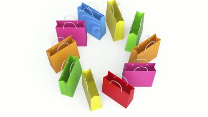 Colorful shopping bags dancing in white background