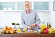 Mature man in the kitchen prepare fruits for breakfast. II