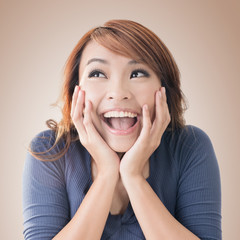 Excited happy Asian girl