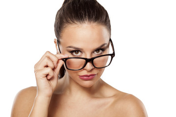 suspicious girl with glasses on a white background