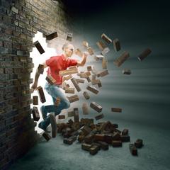 Man running through a brick wall