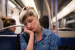Tired young woman intimate portrait inside metro subway. Paris,