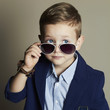 little boy in sunglasses.stylish kid in suit