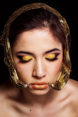 Pretty girl with bijouterie and fashion makeup