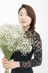 Beautiful asian woman with bouquet of gypsophila