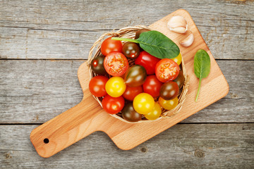 Colorful cherry tomatoes on wooden table