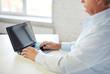 close up of senior man with laptop typing