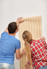 close up of couple holding wallpaper