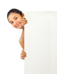 Teen girl holding blank board