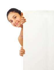 Teen girl holding blank board