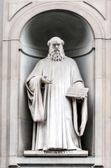 Statue of Guido d'Arezzo in Uffizi Alley in Florence, Italy