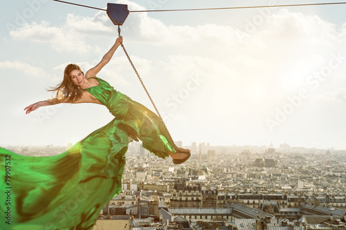 Woman on a ropeway above the city Poster