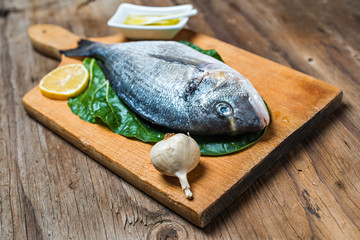 Bream fish preparation. Seafood with vegetables