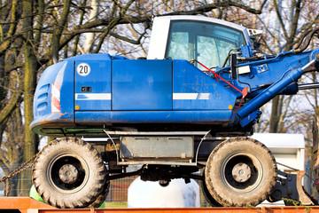 Digger-loader on a trailer