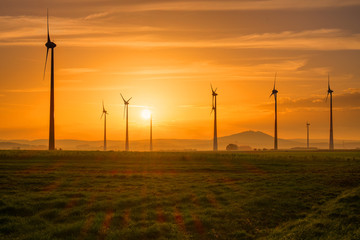 Several wind engines at sunset seen in Germany
