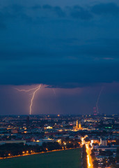 Thunderstorm with lightnings in a city